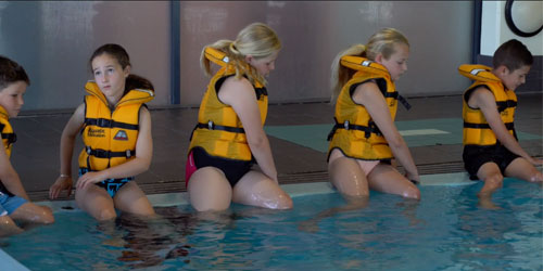 sit and turn pool entry wearing a lifejacket